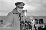 Rear Admiral S. S. Bonham Carter, CB, CVO, DSO, Commanding 18th Cruiser Squadron, whose flagship HMS Edinburgh had the job of welcoming the American Task Force Mid-Atlantic, seen on the bridge of HMS Edinburgh. April 3-4, 1942. Photo: Lt. R. G. G. Coote. Imperial War Museum A 9241
