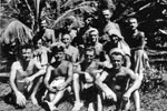 Royal Marine Len Bloomfield is in the back row, second from left, with curly hair