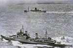 HMS Ceylon escorting the Royal Yacht Gothic to Colombo in April 1954