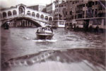 We hired two water taxis for a trip down The Grand Canal, Rialto Bridge, Venice, 1950. Photo from Alan Clements