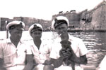 Going ashore at Valletta, the capital city of Malta. Ordnance Artificer Jack Sturges, Electrical Artificers Algy Longworth and Alan Clements with a little friend. Photo from Alan Clements
