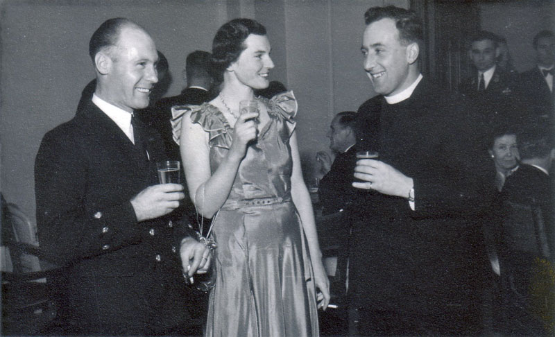 Electrical Artificer Alan Clements with Robert Pope and wife at a Ship's Dance (1950 - 1952)