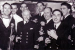 Christmas Day 1950. Electrical Senior Rates invited to the wardroom for drinks. Mr Wannicott clowning around, Moe Symons less jacket, Comdr. Elect with his relief Comdr Lock to Alan Clements' right, Barry Partridge and Bruce? Photo from Alan Clements