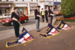 Standard Bearers at the War Memorial, Leamington Spa in 1992. Left to right: Ron Capers, Leamington Standard Bearer; Tony Hockenhull? HMS Gambia Association Standard Bearer; Alan Fletcher, Warwick Branch Standard Bearer. This photo was kindly submitted by Ian Frost of Leamington Spa RNA