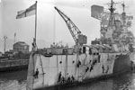 HMS Anson being painted by her crew on December 21, 1943 at Rosyth. Photo: Lt. E. A. Zimmerman. Imperial War Museums A 21080