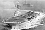 HMS Centaur with HMS Albion astern on December 10, 1954 near Malta. These ships used the latest developments at the time such as angled flight decks and the mirror sight deck landing aid. Imperial War Museum A 33086