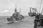 HMS Frobisher escorting a convoy, shown closing up on a troop ship to give orders verbally. June 16, 1942. Photo: Lt. F. G. Roper. Imperial War Museum A 10352