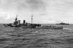 HMS Frobisher escorting a convoy of troop carriers in the Indian Ocean. June 16, 1942. Photo: Lt. F. G. Roper. Imperial War Museums A 10353