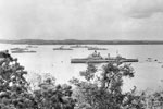 Ships of the Royal Navy, the Pakistan Navy, the Royal Ceylon Navy and the Indian Navy assembled at Trincomalee for Commonwealth naval exercises in August 1955. HMS Gambia is in the foreground. Imperial War Museums A 33348