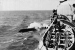 HMS Gambia firing a torpedo on exercise off of Lanarka, Cyprus in 1951. Dad's photo