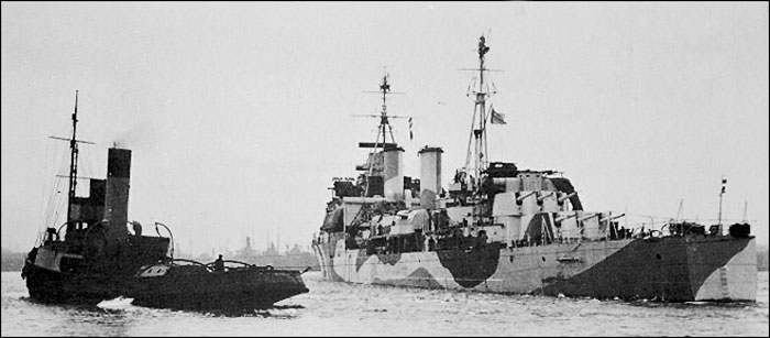 HMS Gambia being towed out - February 1942