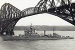 HMS Gambia passing under Forth Bridge going to Rosyth, Scotland. No date