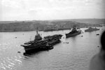 The Royal Navy anchorage at Grand Harbour, Malta around 1951. Vessels at anchor include Colossus class light fleet carrier HMS Warrior(foreground), United States Navy cruiser USS Des Moines (middle) and Fiji class cruiser HMS Gambia(background). My father would have been on Gambia when this photo was taken, but a year and a half later was transferred to Warrior. Imperial War Museum A 32043