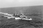 HMS Gambia underway at sea. It is thought this was taken in August 1942, during speed trials when HMS Gambia was at 16 knots. Photo: Lt. H.A. Mason. Imperial War Museum A 12929