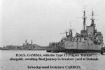 HMS Gambia with the type 15 frigate, HMS Rocket alongside awaitingthe final ourney to the breakers yard at Dlmuir. In the background is the destroyer HMS Carron.