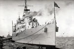 HMS Gambia moored during the 1950-52 commission. Photographer and place unknown