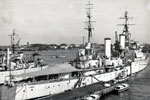 HMS Gambia moored in the Suez Canel during the 1950-52 commission. Photographer unknown