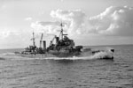 HMS Mauritius at high speed, August 1942. Photo: Lt. H. A. Mason. Imperial War Museums A 11310