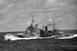 HMS Mauritius at speed during WWII. Imperial War Museums A11657