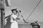 Admiral Sir James Somerville, C in C Eastern Fleet, watches operations from the bridge of HMS Queen Elizabeth. Operation Cockpit against Sabang, April 19, 1944. Photo: Lt. C. Trusler. Imperial War Museums A 23479