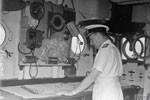 Admiral Sir James Somerville, C in C Eastern Fleet, on the Admiral's bridge of HMS Queen Elizabeth looks at the chart. Operation Cockpit against Sabang, April 19, 1944. Photo: Lt. C. Trusler. Imperial War Museums A 23480