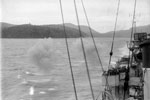 HMS Quilliam firing a starboard broadside on Sabang. Operation Crimson, July 25, 1944. Photo: Lt. C. Trusler. Imperial War Museums A 25112