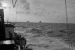 Eastern Fleet big ships returning from Sabang from HMS Racehorse. On the horizon HMS Renown and FS Richelieu, with (nearer the camera) cruisers HMS Kenya, Cumberland and HMNZS Gambia  Operation Crimson, July 25, 1944. Photo: Lt. W. E. Rolfe. Imperial War Museums A 25649