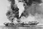 The aircraft carrier HMS Formidable on fire after being struck by a Kamikaze off Sakishima Gunto in May 1945. As seen from HMS Victorious. HMS Formidable was hit by a Kamikaze on May 4 and again on May 9. Imperial War Museums A 29717
