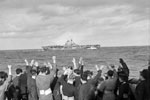 Sailors of HMS Edinburgh greet one of the American ships, USS Wasp in the mid-Atlantic. The task force was under the command of Rear Admiral R. G. Griffen. April 3-4, 1942. Photo: Lt. R. G. G. Coote. Imperial War Museum A 9231