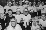 "Christmas Day, 1950. This is 28 & 30 Seaman's Mess, all Radar men. John Harris, the only person who's name I know in this photo is in the tall hat on the right, next to ""Gur"" the Arab. Photo from my dad's albums."