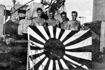 Crew of HMNZS Gambia with a capured Japanese flag