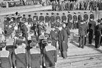 Mr Jordan, High Commissioner of New Zealand, inspecting divisions on the quarterdeck of HMS Gambia during the formal handing over in Liverpool, October 3, 1943. Behind him is the Commanding Officer of the ship, Captain N J W Willam-Powlett, DSC, RN. Photo: Lt. C. H. Parnall. Imperial War Museums A 19580