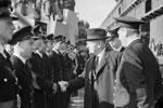 Mr Jordan, High Commissioner of New Zealand, attending the formal handing over of HMS Gambia in Liverpool, October 3, 1943. Here Mr Jordan is talking to officers of the ship. Photo: Lt. C. H. Parnall. Imperial War Museums A 19582
