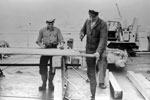 Shipwright Frank Knight of Ewell, Surrey, and OD Alex Wood of Edinburgh, building a platform on HMS Sheffield on June 11, 1953, to enable visiting Sea Cadets to see the Queen on Review Day. Imperial War Museums A32580
