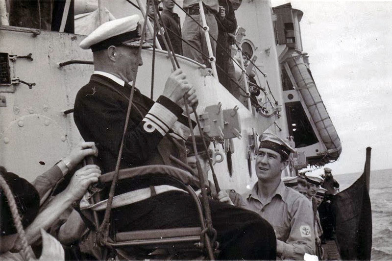Slim Welsby assisting with a jackstay transfer of an admiral in the Mediterranean Sea in 1950