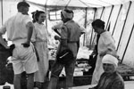 Lady Mountbatten, Commandant of the St Johns Ambulance Brigade, talking to Greek nurses in a medical tent set up by HMS Theseus' medical officer, August 1953. Image from Imperial War Museums, A32636