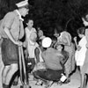 Naval ratings from HMS Daring administering first aid to sick refugees from Argostoli, August 1953. Image from Imperial War Museums, A32637