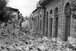 A devastated street in Argostoli showing blockage in street with fallen masonry, August 1953. Image from Imperial War Museums, A32648