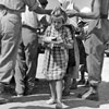 A child served with rations at a field kitchen, 'South Camp', Zante, August 1953. Image from Imperial War Museums, A32694