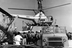 Helicopters are brought to Zante by HMS Bermuda to carry out aerial surveys, August 1953. Image from Imperial War Museums, A32690