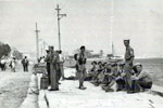 Royal Marines from HMS Gambia waiting to return to the ship, August 1953. Image from Stan Coulding